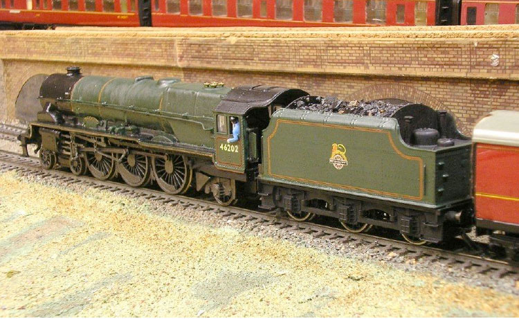 Note the Stanier Mk1 4,000 gallon 9 ton tender and stepped footplate.